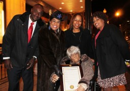 Photo- Congresswoman Wilson with Desiline Victor and her family